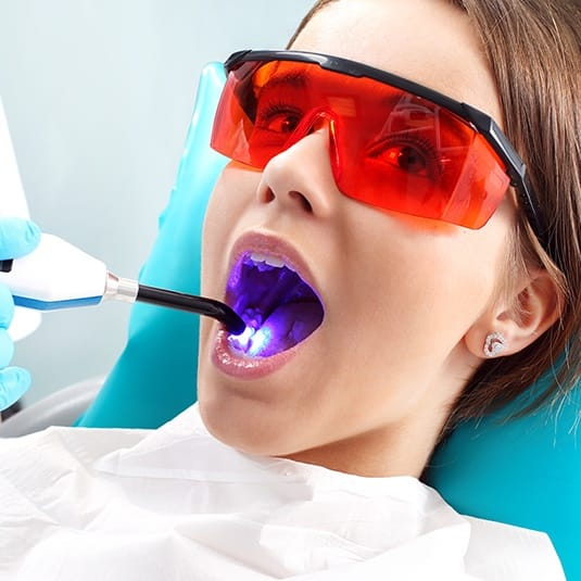 preteen getting dental sealants