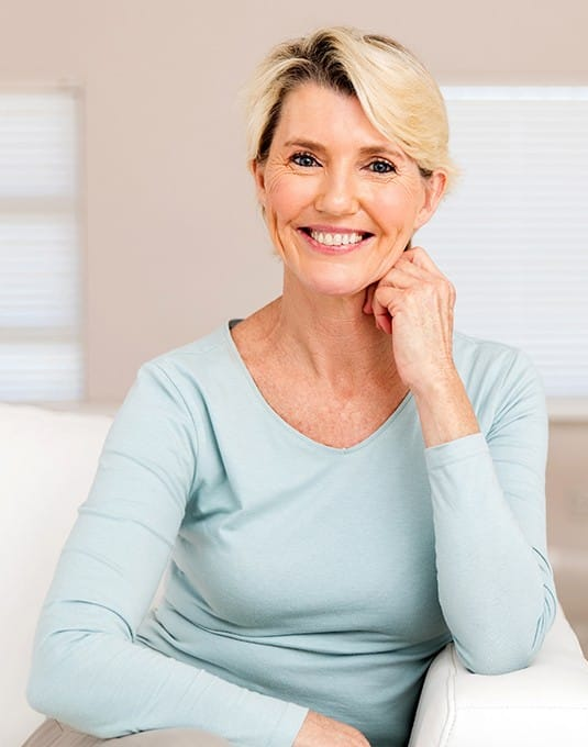 woman in light blue shirt smiling