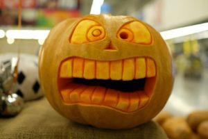 scared face carved into orange pumpkin